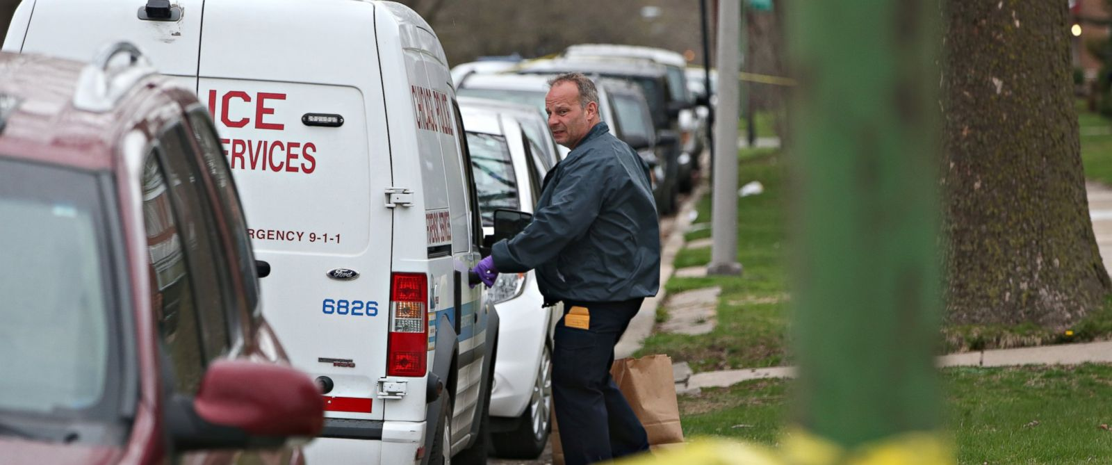 PHOTO: An investigator opens the door of a vehicle outside a home on the South Side of Chicago, April 10, 2017, after Cook County Circuit Court Raymond Myles was shot to death outside his home.