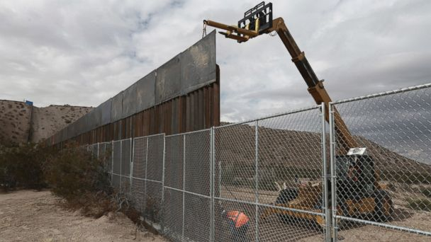 PHOTO: Workers raise a taller fence along the Mexico-U.S. border between the towns of Anapra, Mexico and Sunland Park, New Mexico, Nov. 10, 2016.
