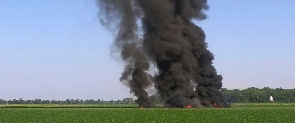 PHOTO: Smoke and flames rise into the air after a military transport airplane crashed in a field near Itta Bena, Miss., on the western edge of Leflore County, July 10, 2017, killing several.