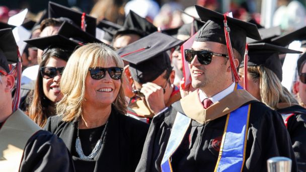 PHOTO: Judy O'Connor, center, sits with her son, MBA graduate Marty O'Connor, during commencement at Chapman University in Orange, Calif., May 20, 2017.