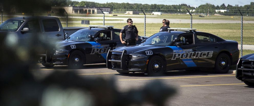 PHOTO: Burton Police Officers gather at Bishop International Airport, June 21, 2017, in Flint, Mich.