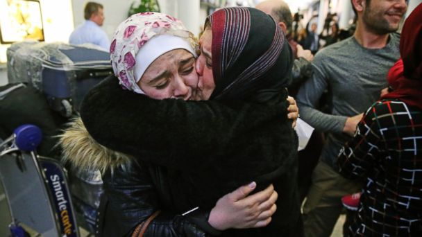 PHOTO: Baraa Haj Khalaf, left, gets a kiss from her mother, Fattuom Bakir, after arriving at O'Hare International Airport, in Chicago, on Feb. 7, 2017.