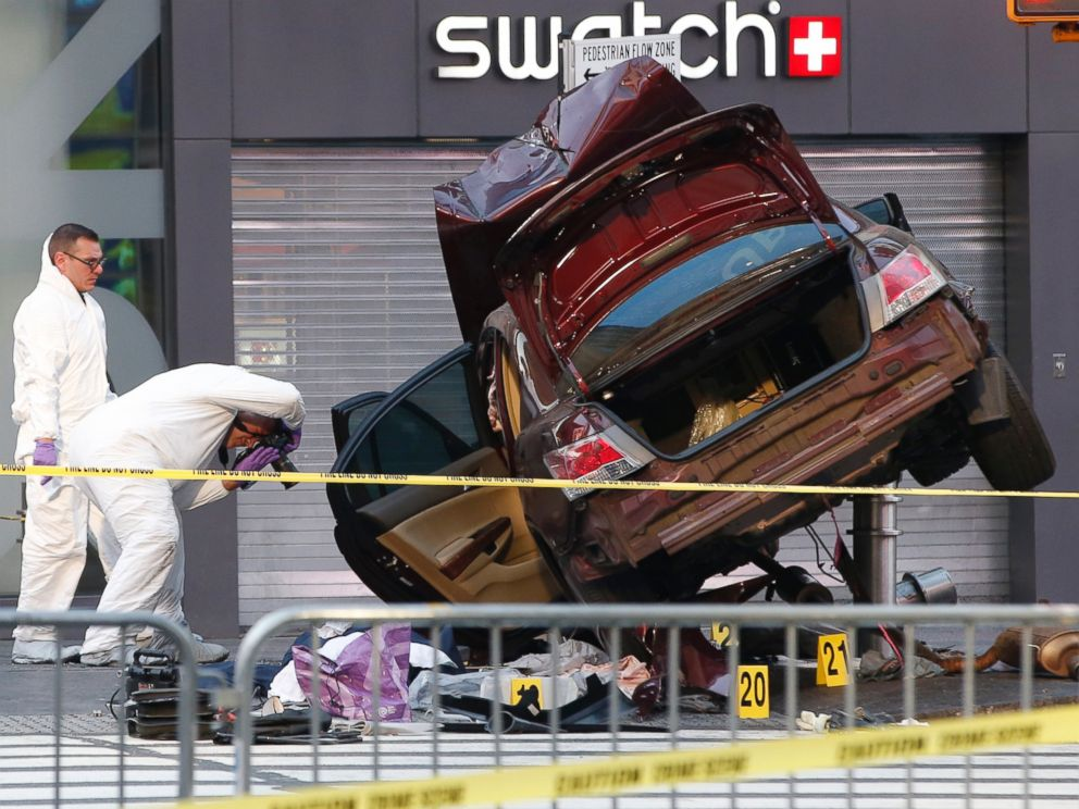PHOTO:Investigators photograph evidence at the scene of a crash that killed one person and injured almost two dozen others in Times Square, May 18, 2017, in New York.