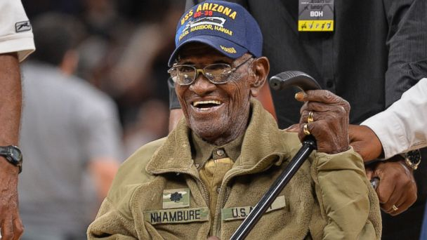 PHOTO: Richard Overton leaves the court after a special presentation honoring him as the oldest living American war veteran, during a timeout in an NBA basketball game between the Memphis Grizzlies and the San Antonio Spurs, on March 23, 2017.