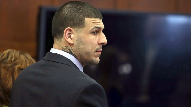 PHOTO: Former New England Patriots tight end Aaron Hernandez stands at the defense table during his double murder trial at Suffolk Superior Court, April 13, 2017, in Boston.