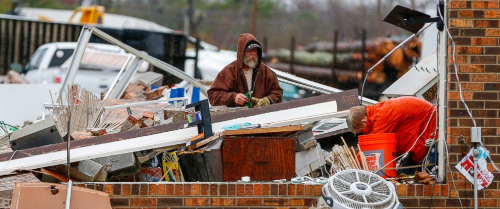 PHOTO: People clean up a business at Rosalie Plaza after a tornado ripped through the town, Nov. 30, 2016, in Rosalie, Ala.