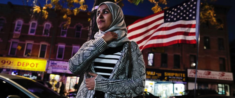 PHOTO: Enas Almadhwahi, an immigration outreach organizer for the Arab American Association of New York, stands for a photo along Fifth Avenue in the Bay Ridge neighborhood of Brooklyn, Nov. 11, 2016, in New York.