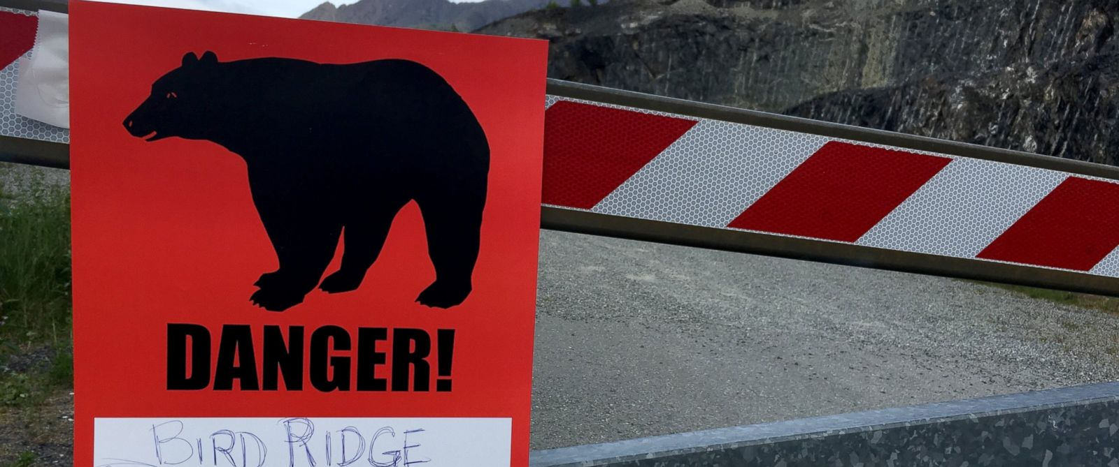 PHOTO: A sign warns people that the trail ahead is closed, June 19, 2017, after a fatal bear mauling at Bird Ridge Trail in Anchorage, Alaska.