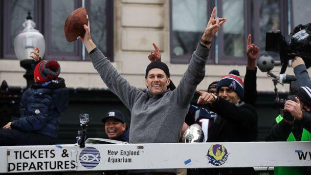 PHOTO: New England Patriots quarterbacks Tom Brady and Jimmy Garoppolo, right, wave during a parade, Feb. 7, 2017, in Boston.