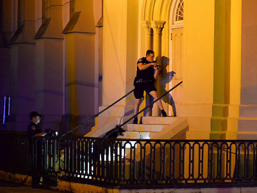 PHOTO: Charleston police officers search for a shooting suspect outside the Emanuel AME Church, in downtown Charleston, South Carolina, June 17, 2015.