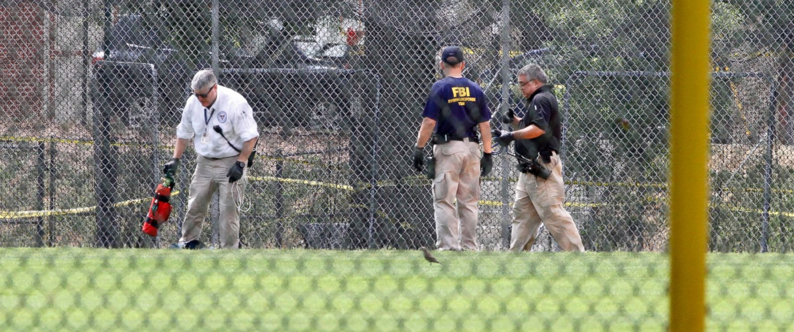 PHOTO: FBI agents continue to search for evidence on the baseball field in Alexandria, Va., June 15, 2017, the day after House Majority Whip Steve Scalise of La. was shot during during a congressional baseball practice.