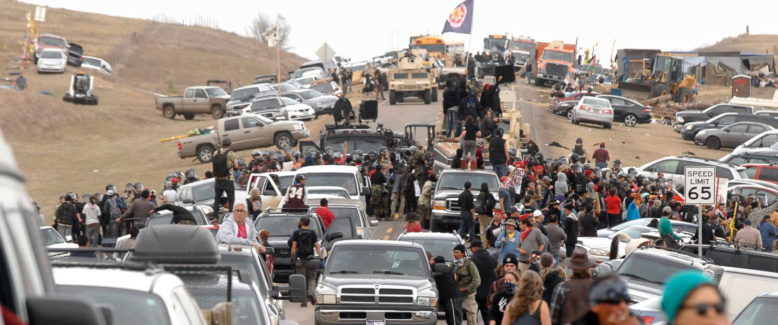 PHOTO: Dakota Access Pipeline protesters move south on Highway 1806 as a line of law enforcement slowly push the protest effort from the Front Line Camp to the Oceti Wakoni overflow camp in Morton County, North Dakota, Oct. 27, 2016.