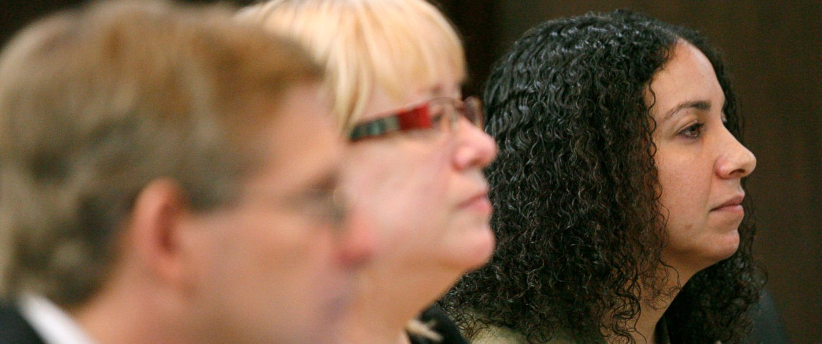 PHOTO: Hannah Overton, far right, sits next to her attorney, Cynthia Orr, center, and prosecutor, Doug Norman, April 26, 2012, in Corpus Christi, Texas.