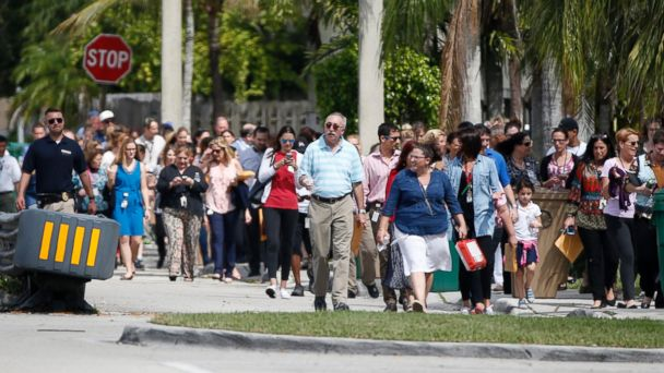 PHOTO: People evacuated because of a bomb threat return to the David Posnack Jewish Community Center and David Posnack Jewish Day School, Feb. 27, 2017, in Davie, Fla.