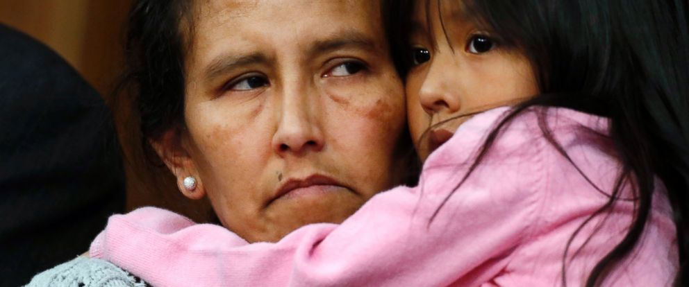 PHOTO: Jeanette Vizguerra, left, a Mexican woman seeking to avoid deportation from the United States, cradles her 6-year-old daughter, Zuri, during a news conference in a church in which she and her children have taken refuge, Feb. 15, 2017, in Denver.