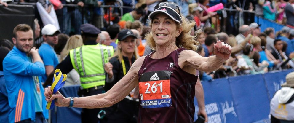 PHOTO: Kathrine Switzer, who was the first official woman entrant in the Boston Marathon 50 years ago, crosses the finish line in the Boston Marathon, April 17, 2017, in Boston.