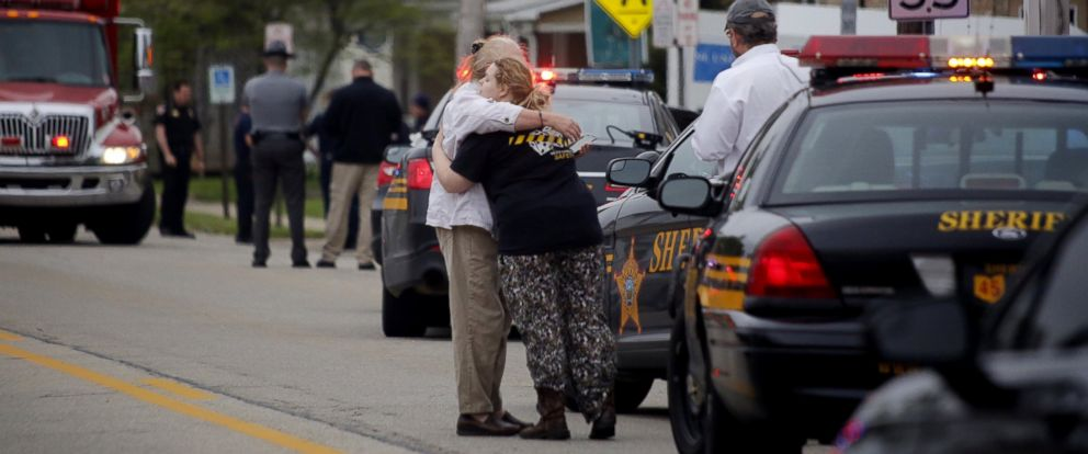 PHOTO: People hug as emergency personnel arrive to the scene of a shooting outside Pine Kirk nursing home in Kirkersville, Ohio, May 12, 2017.