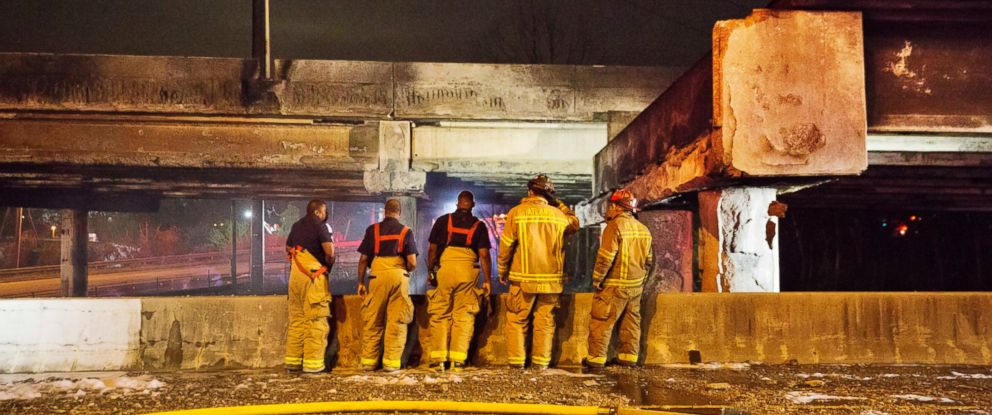 PHOTO: Firefighters survey the section of an overpass that collapsed from a large fire on Interstate 85 in Atlanta, March 30, 2017.