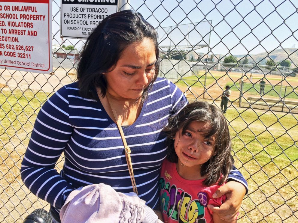 PHOTO: Elizabeth Barajas hugs her daughter, Marissa Perez, 9, following their reunion as Marissa recounted her experiences being in the classroom in which her teacher was shot to death at North Park Elementary School in San Bernardino, Calif.