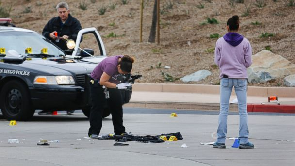 PHOTO: Members of the San Diego Police Department collect evidence at the scene of a fatal police officer involved shooting of a 15-year-old boy in one of the parking lots in front of Torrey Pines High School, early Saturday morning, May 6, 2017.