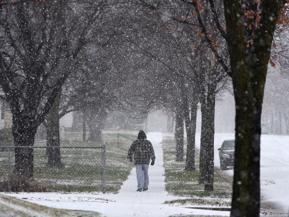 PHOTO: A man walks during a snow storm, Nov. 18, 2016, in St. Cloud, Minnesota.