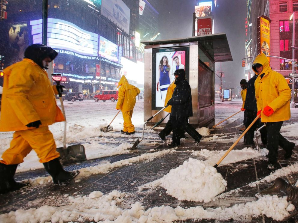 PHOTO: A crew works to remove snow as a snowstorm sweeps through Times Square, March 14, 2017, in New York.