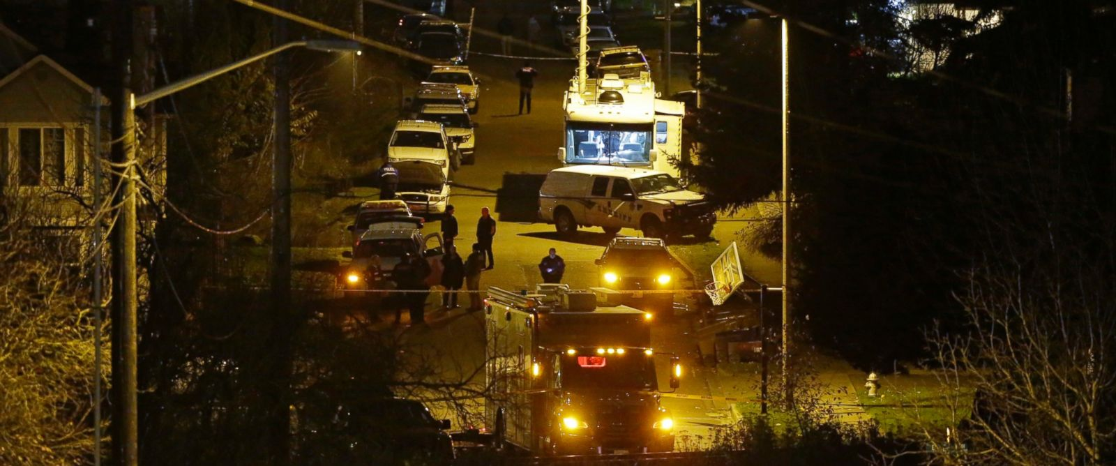 PHOTO: Law enforcement vehicles line East 52nd Street in Tacoma, Washington, Dec. 1, 2016, near the home where a Tacoma Police Officer was fatally shot.