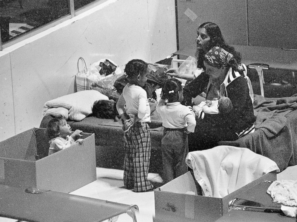 PHOTO: Kathy Moody uses a cardboard box for a playpen for her daughter while they wait in the evacuation center at Hershey sports arena for radiation from the Three Mile Island nuclear power plant to stop, March 31, 1979.