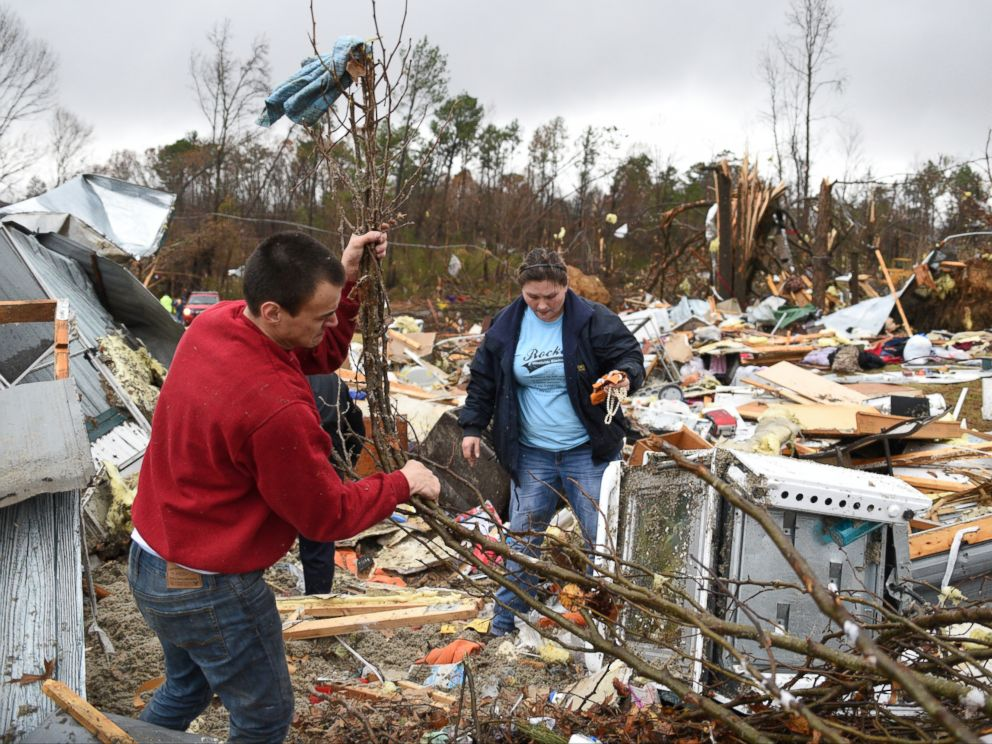 PHOTO: Chris Graves, left, and Jennifer Jeske sort through items, Nov. 30, 2016, from the remains of a mobile home where two people were killed in Polk County after a tornado swept through the area.