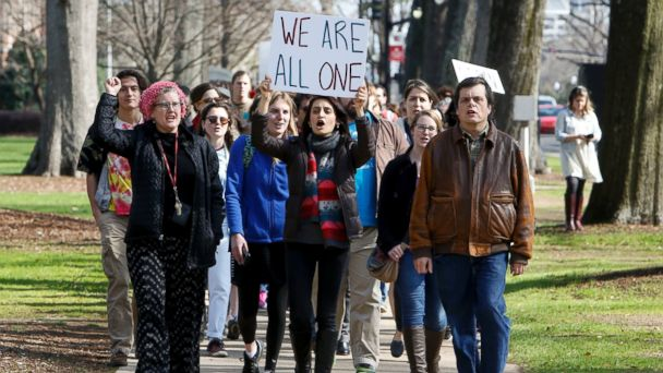 PHOTO: Demonstrators chant and wave signs as they march at the University of Alabama in Tuscaloosa, Ala., to support an open campus and oppose the travel ban imposed by President Donald Trump, Feb. 9, 2017.