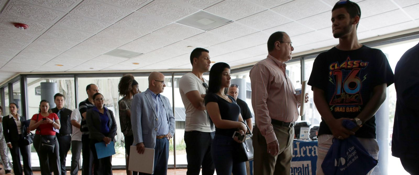 PHOTO: People stand in line to register for a job fair in Miami Lakes, Fla., July 19, 2016, file.