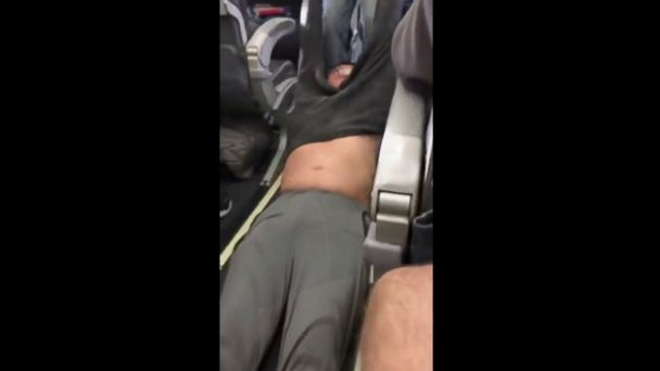 PHOTO: This Sunday, April 9, 2017, image made from a video provided by Audra D. Bridges shows a passenger being removed from a United Airlines flight in Chicago.