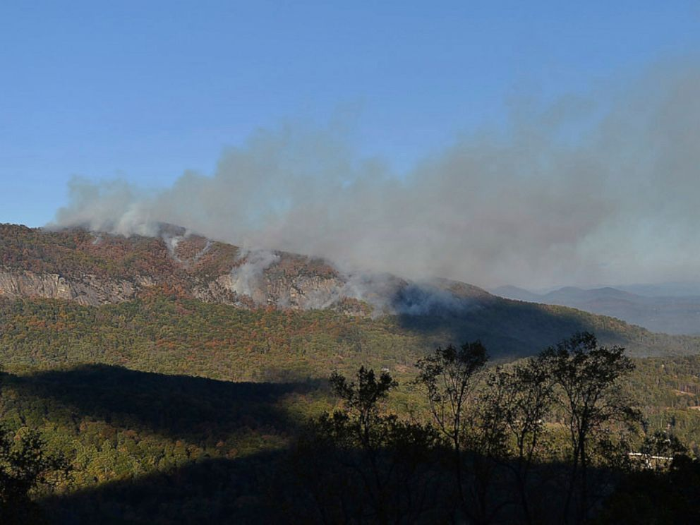 PHOTO: In this Wednesday, Nov. 9, 2016 photo, a wildfire burns near Lake Lure, North Carolina. A state of emergency is in effect for 25 western North Carolina counties where active wildfires are burning, caused by the drought that began last spring.