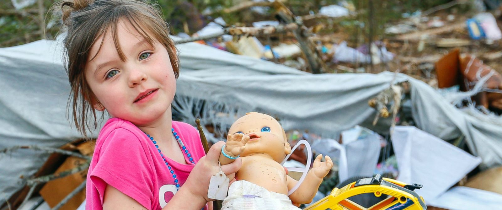 PHOTO: Serenity Brooks, 5, holds a baby doll as she digs for her belongings after a suspected tornado ripped through the town of Rosalie, Ala., Wednesday, Nov. 30, 2016.