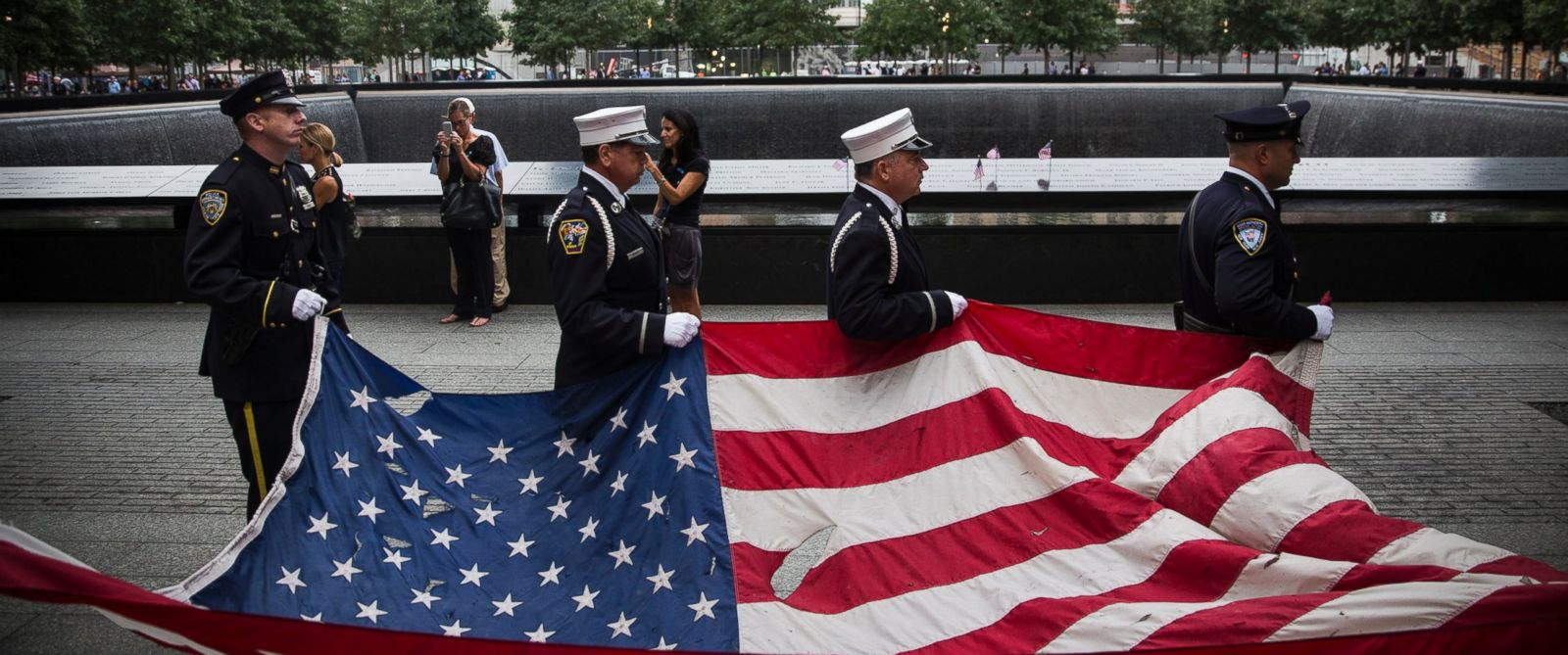 PHOTO: Members of the New York Police Department, Fire Department of New York and Port Authority of New York and New Jersey Police Department carry an American flag at the beginning of the memorial observances in New York, Sept. 11, 2014.