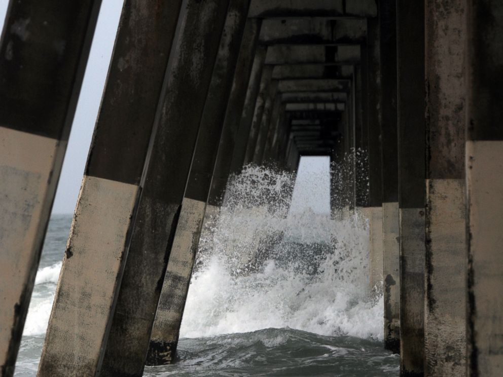 PHOTO: Waves crash around the Johnnie Mercers Fishing Pier at Wrightsville Beach, N.C., July 3, 2014.