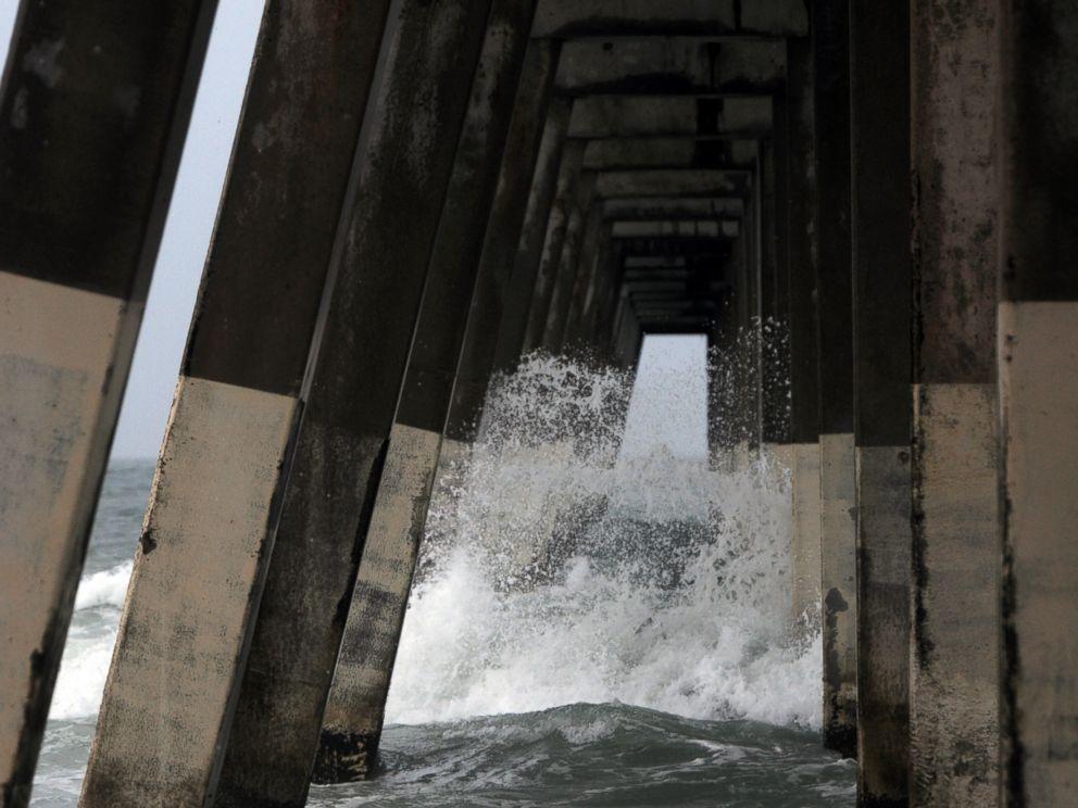 PHOTO: Waves crash around the Johnnie Mercers Fishing Pier at Wrightsville Beach, N.C., July 3, 2014.