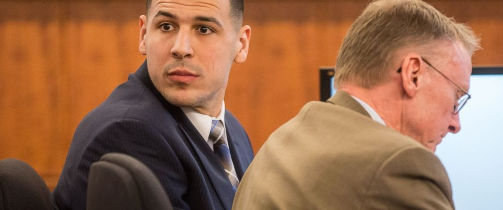 PHOTO: Former New England Patriots football player Aaron Hernandez, left, looks back as he sits with his attorney Charles Rankin during his murder trial, Feb. 13, 2015, in Fall River, Mass.