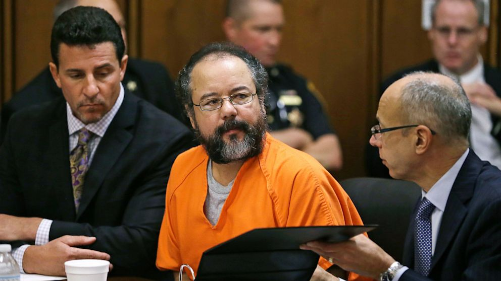 Ariel Castro, center, listens  in the courtroom during the sentencing phase, Aug. 1, 2013, in Cleveland.