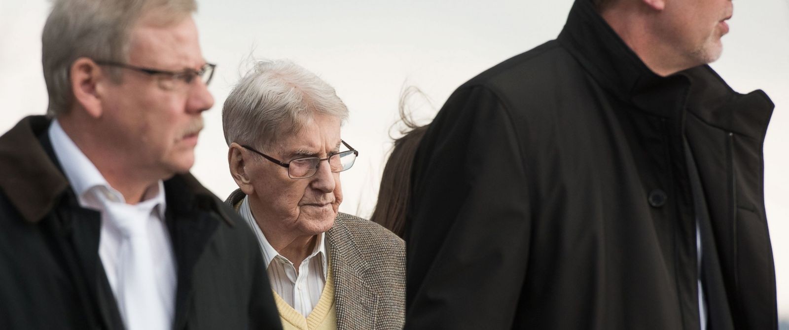 PHOTO: 94-year-old former SS guard at the Auschwitz death camp Reinhold Hanning, center, leaves the building with his lawyers after the opening of his trial in Detmold, Germany, Feb. 11, 2016.