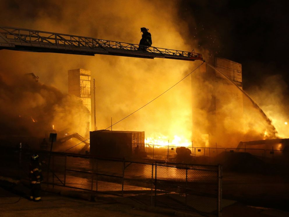 Firefighters battle a blaze, Monday, April 27, 2015, after rioters plunged part of Baltimore into chaos, torching a pharmacy, setting police cars ablaze and throwing bricks at officers.