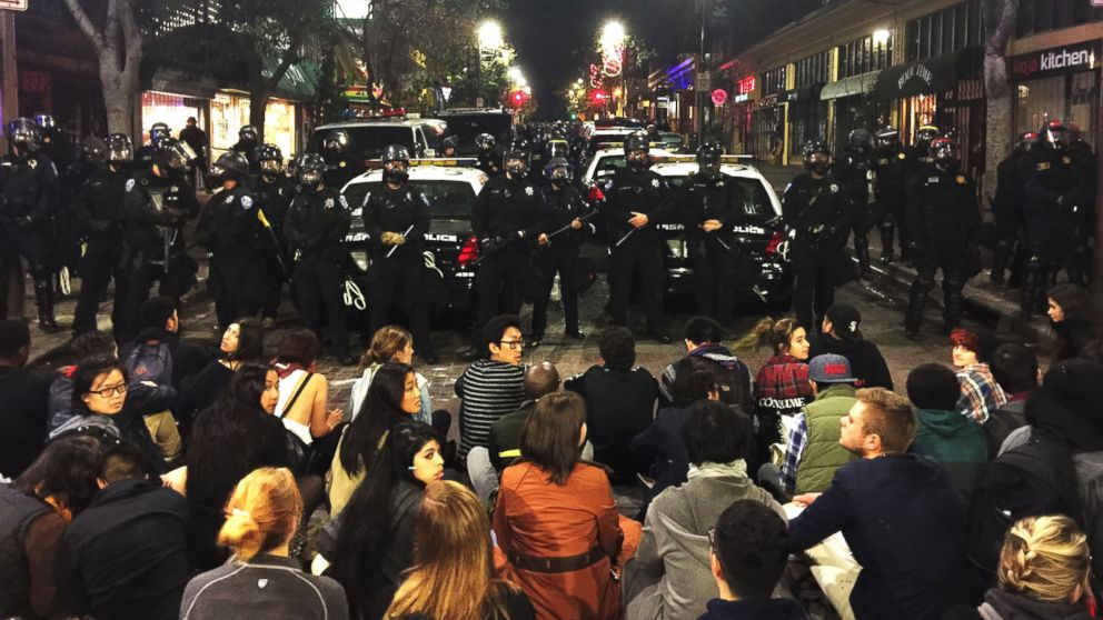 This photo provided by Gabriel Reyes shows the protest in Berkeley, Calif., Sunday, Dec. 7. 2014. Three officers and a technician were hurt and six people arrested in Northern California when a protest over police killings turned violent.