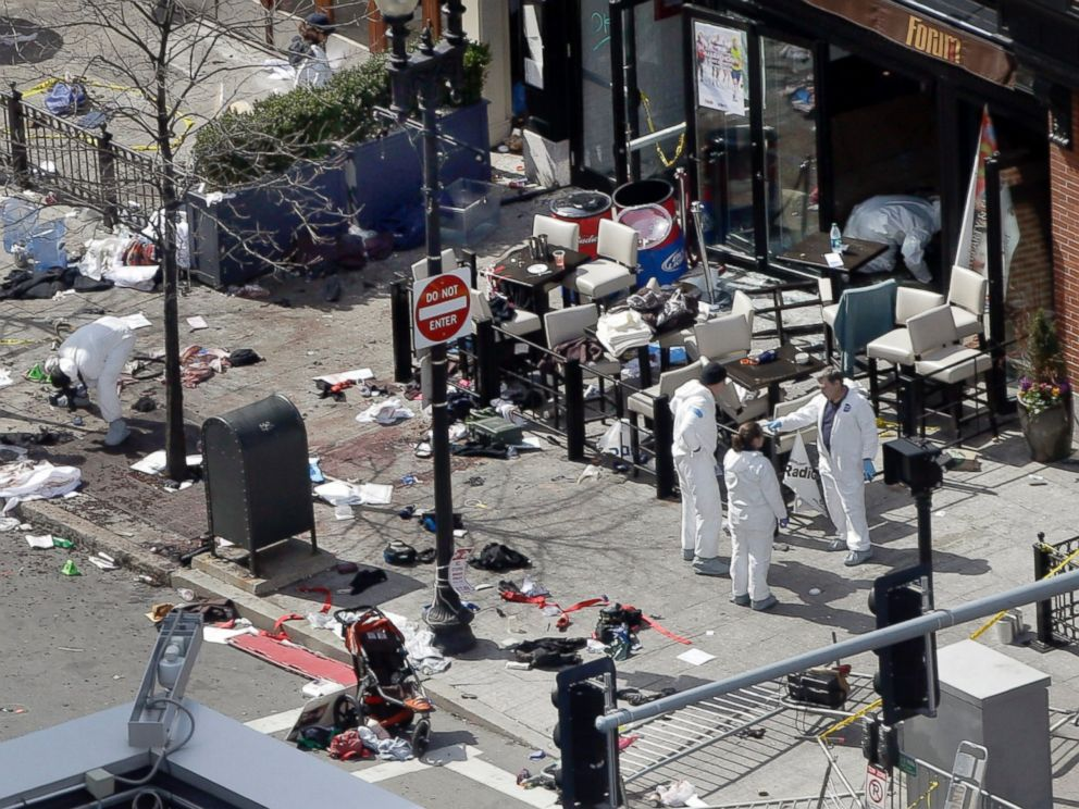 PHOTO:This April 15, 2013 and April 10, 2014 photos show a view of Boylston Street in front of the Forum restaurant, where investigators comb for evidence at the site where the second of two bombs exploded near the finish line of the 2013 Boston Marathon.