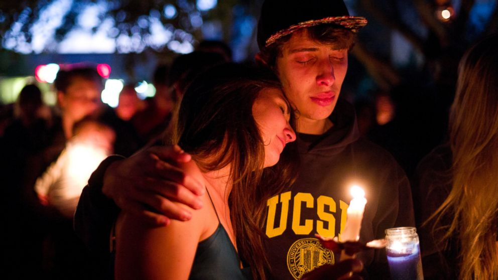 PHOTO: Two students comfort each other during a May 24, 2014 candlelight vigil held to honor the victims of a mass shooting in Isla Vista, Calif.