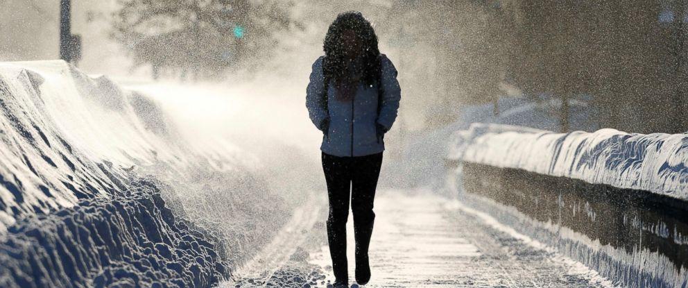 PHOTO: A woman walks through drifting snow in Cambridge, Mass., Feb. 15, 2015.