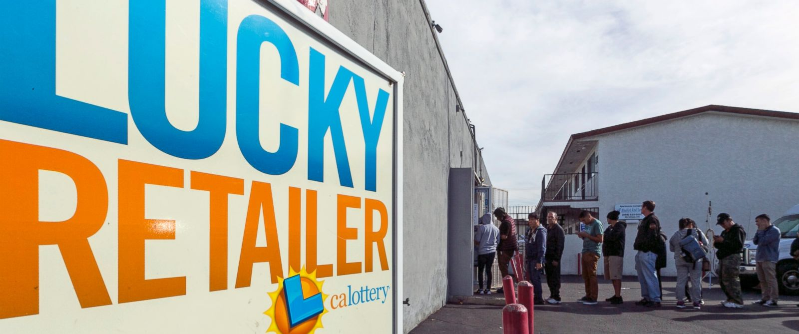 PHOTO: A California Lucky Retailer sign is posted outside the Blue Bird Liquor store as customers wait in line to buy lottery tickets in Hawthorne, Calif. With $63 million on the line, the mystery remains: Where? is the winning California Lottery ticket?
