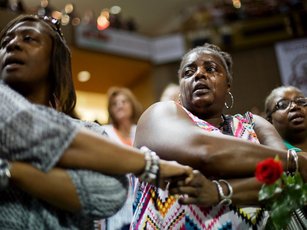 PHOTO: Barbara Lloyd, of Charleston, S.C., cries as she joins hands with mourners during the singing of We Shall Overcome at a memorial service for the victims of the shooting at Emanuel AME Church, Friday, June 19, 2015, in Charleston, S.C.