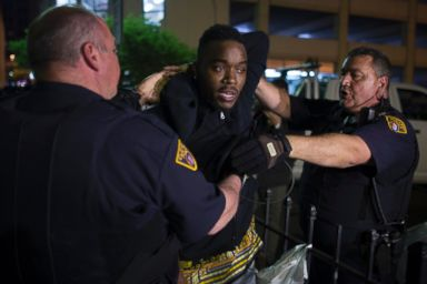 PHOTO: A demonstrator is arrested during a protest against the acquittal of Michael Brelo, a patrolman charged in the shooting deaths of two unarmed suspects, Saturday, May 23, 2015, in Cleveland.