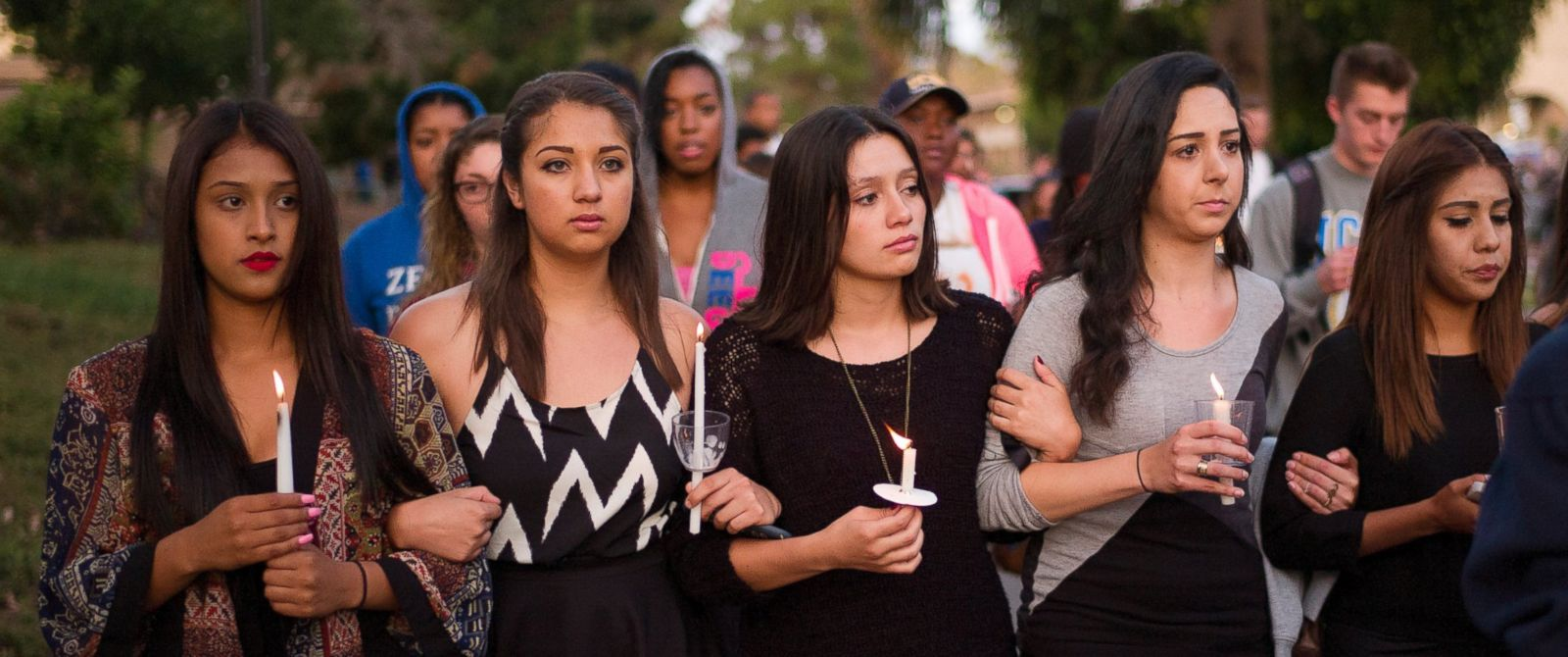 PHOTO: Students march on the campus of the University of California, Santa Barbara during a candlelight vigil held to honor the victims of Friday nights mass shooting on May 24, 2014, in Isla Vista, Calif.