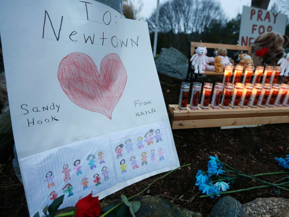 PHOTO: A childs message rests with a memorial for shooting victims, Dec. 16, 2012, in Newtown, Conn.